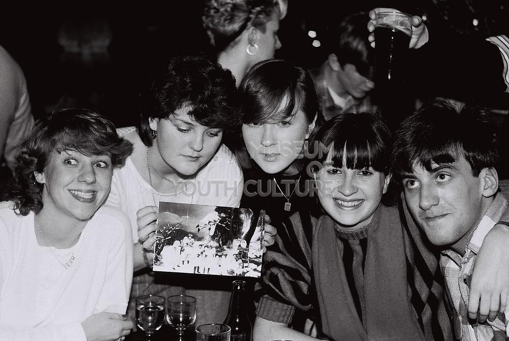 Teenagers at the pub on Christmas Eve, London, UK, 1983