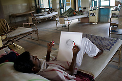 A patient at the Group of TB Hospitals in Mumbai draws a portrait of a nurse's daughter.<br />