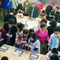 Chinese react to the news of the death of Apple founder Steve Jobs outside the Apple store.