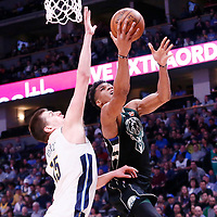01 April 2018: Milwaukee Bucks forward Giannis Antetokounmpo (34) goes for the layup past Denver Nuggets center Nikola Jokic (15) during the Denver Nuggets 128-125 victory over the Milwaukee Bucks, at the Pepsi Center, Denver, Colorado, USA.