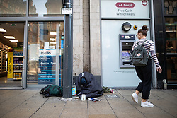 © Licensed to London News Pictures . 24/10/2018. Leeds , UK . A man slumped over and wrapped up on the pavement outside Tesco on Boar Lane . At least six people sleeping rough have died in the Metropolitan Borough of the City of Leeds since March 2017 and West Yorkshire Police say they responded to 66 reported cases of people suffering the effects of Spice in July 2018 , a large increase on previous months . Photo credit : Joel Goodman/LNP