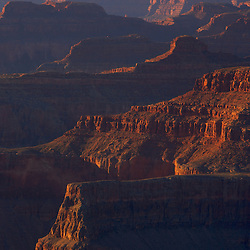 Cliffs and rock formations at the Grand Canyon South Rim, AZ at sunset.