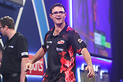 Damon Heta wins his first round match against Jose De Sousa and celebrates during the PDC William Hill World Darts Championship at Alexandra Palace, London, United Kingdom on 17 December 2019.