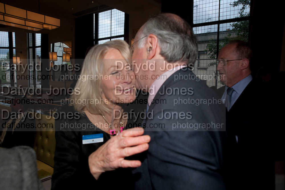 SANDRA HOWARD; MICHAEL HOWARD, Literary charity First Story fundraising dinner. Cafe Anglais. London. 10 May 2010. *** Local Caption *** -DO NOT ARCHIVE-© Copyright Photograph by Dafydd Jones. 248 Clapham Rd. London SW9 0PZ. Tel 0207 820 0771. www.dafjones.com.<br /> SANDRA HOWARD; MICHAEL HOWARD, Literary charity First Story fundraising dinner. Cafe Anglais. London. 10 May 2010.