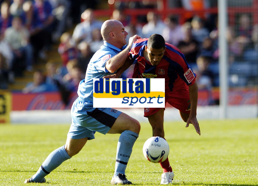 Photo: Olly Greenwood.<br />Crystal Palace v Coventry City. Coca Cola Championship. 23/09/2006. Palace's Jobi McAnuff gets past Coventy's Matt Heath