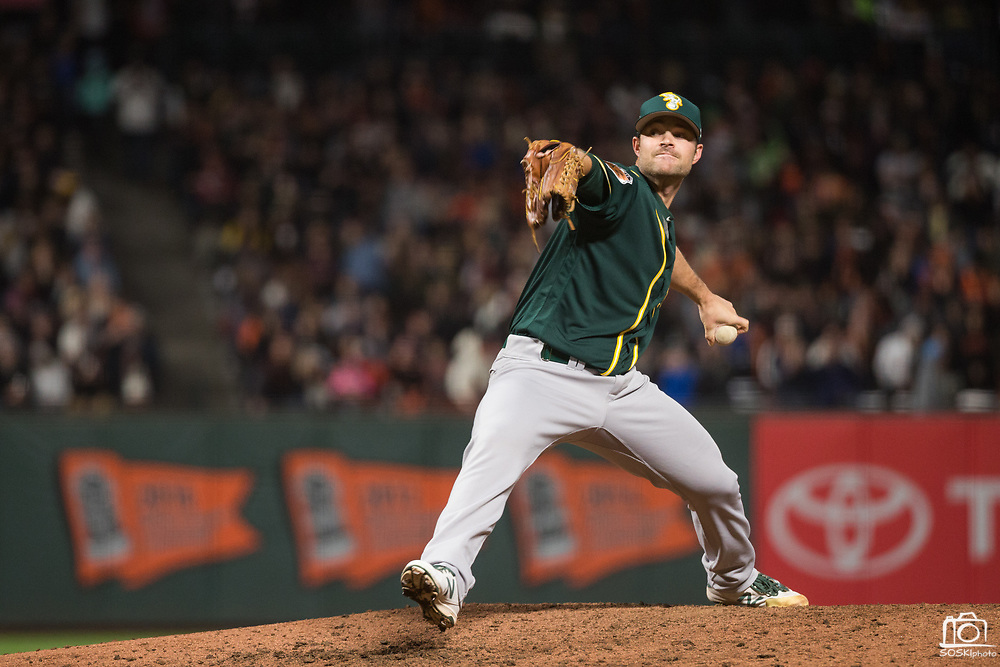 Oakland Athletics relief pitcher Daniel Coulombe (35) pitches against the San Francisco Giants at AT&T Park in San Francisco, California, on March 30, 2017. (Stan Olszewski/Special to S.F. Examiner)