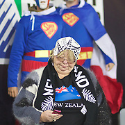 A New Zealand fan checks her phone as two french fans stand in the background during the Wales V France Semi Final match at the IRB Rugby World Cup tournament, Eden Park, Auckland, New Zealand, 15th October 2011. Photo Tim Clayton...