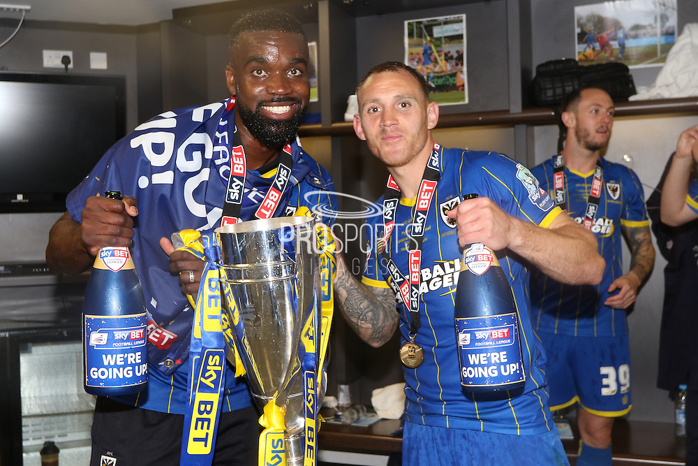 Barry Fuller (Captain) defender for AFC Wimbledon (2), Karleigh Osborne defender for AFC Wimbledon (22)  celebrate as AFC Wimbledon win promotion to league 1after the Sky Bet League 2 play off final match between AFC Wimbledon and Plymouth Argyle at Wembley Stadium, London, England on 30 May 2016. Photo by Stuart Butcher.