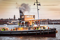 "© Licensed to London News Pictures. 04/05/2016. Birkenhead UK. Picture shows the Daniel Adamson making it's first public appearance for 30 years traveling across the Mersey last night from the Camel Laird ship yard to Canning Dock in Liverpool. The Daniel Adamson steam boat has been bought back to operational service after a £5M restoration. The coal fired steam tug is the last surviving steam powered tug built on the Mersey and is believed to be the oldest operational Mersey built ship in the world. The ""Danny"" (originally named the Ralph Brocklebank) was built at Camel Laird ship yard in Birkenhead & launched in 1903. She worked the canal's & carried passengers across the Mersey & during WW1 had a stint working for the Royal Navy in Liverpool. The ""Danny"" was refitted in the 30's in an art deco style. Withdrawn from service in 1984 by 2014 she was due for scrapping until Mersey tug skipper Dan Cross bought her for £1 and the campaign to save her was underway. Photo credit: Andrew McCaren/LNP ** More information available here http://tinyurl.com/jsucxaq **"