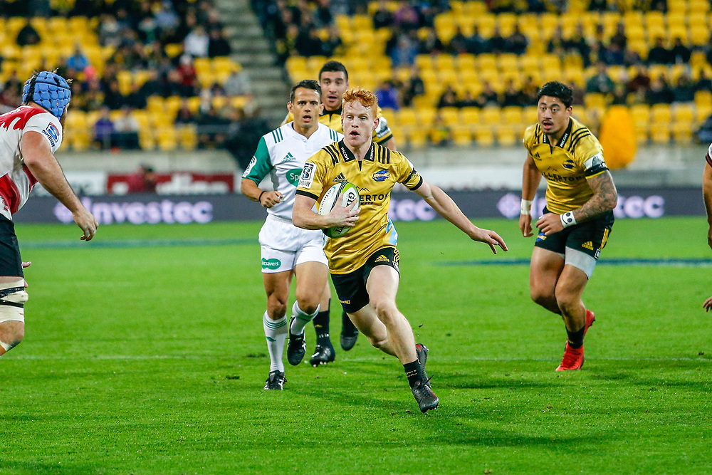 Finlay Christie running with the ball  during the Super rugby (Round 12) match played between Hurricanes  v Lions, at Westpac Stadium, Wellington, New Zealand, on 5 May 2018.  Hurricanes won 28-19.