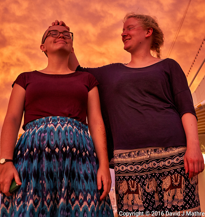 Maria and Charlette at dawn. The sky was really that color. From the aft deck of the MV World Odyssey. Day 65 of 103 of the Semester at Sea Spring 2016 Voyage at sea between Mauritius and South Africa. Image taken with a Fuji X-T1 camera and 23 mm f/1.4 lens (ISO 800, 23 mm, f/4.5, 1/60 sec)