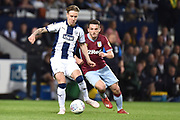 West Bromwich Albion midfielder (on loan from Fulham) Stefan Johansen (6) battles for possession  with Aston Villa midfielder John McGinn (7) during the EFL Sky Bet Championship play-off second leg match between West Bromwich Albion and Aston Villa at The Hawthorns, West Bromwich, England on 14 May 2019.
