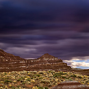 Storm clouds move over the sandstone desert formations near Page, Arizona.