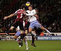 Photo: Paul Thomas.<br /> Sheffield United v Aston Villa. The Barclays Premiership. 11/12/2006.<br /> <br /> Chrin Morgan (5) crashes into Chris Sutton (20) of Villa.