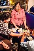 Khmer women share picnic dinner on board Royal Railway passenger car