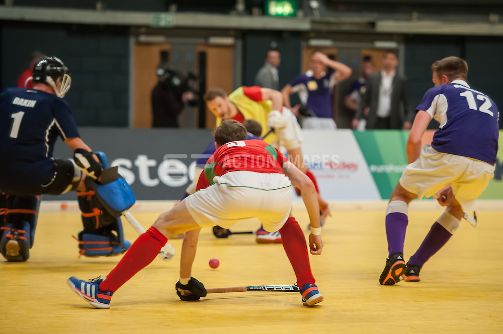 Canterbury's Liam Foster guides the ball home to scor the winning goal. Sevenoaks v Canterbury - Hockey 5s, SSE Arena, Wembley, London, UK on 25 January 2015. Photo: Simon Parker