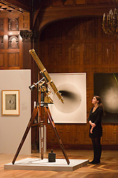 © Licensed to London News Pictures. 30/01/2014. London, England. Picture: Royal Century refracting telescope on equatorial mount c. 1910