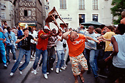 FRANCE. Blois. 2006. Youths from the suburbs attack someone in the centre of town during the World Cup Final.