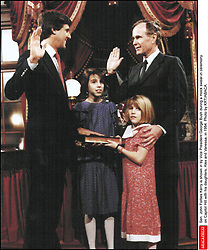 Sen. John Forbes Kerry is shown in by Vice President George Bush during a mock swear-in ceremony on Capitol Hill with his daughters, Alex and Vanessa, in 1984. Photo by KRT/ABACA.