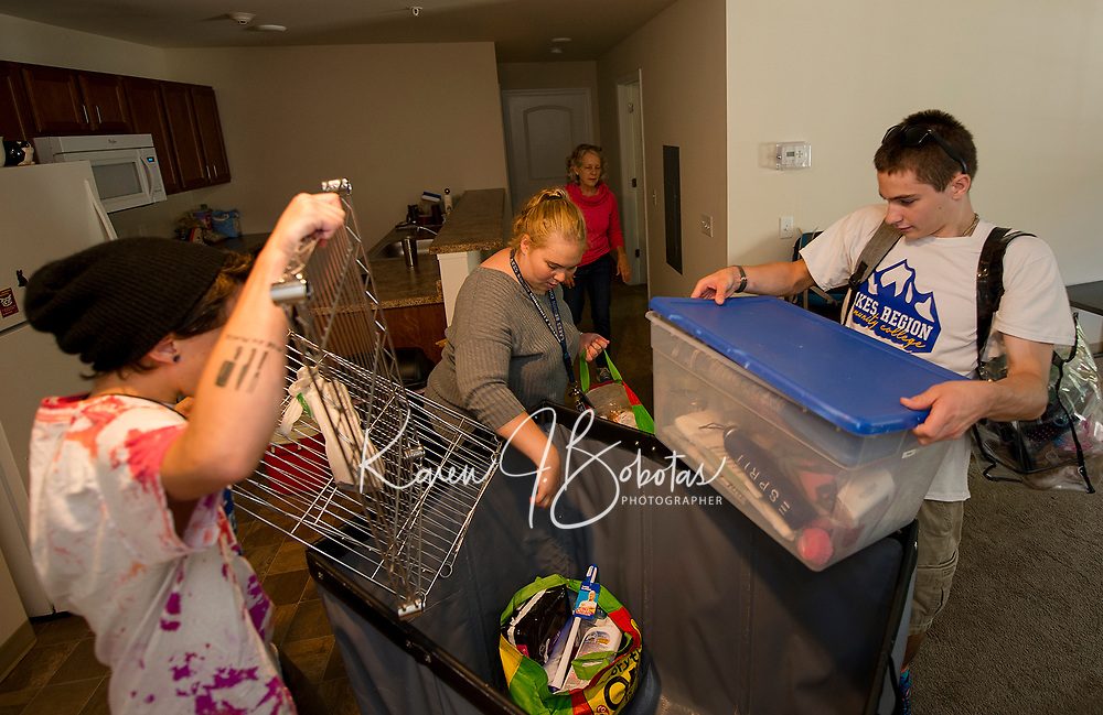 Raymond Townsend, Sarah Simpson, Samuel Avard and Molly Simpson help Sarah Simpson move in to her apartment at Apple Ridge during Move In day at Lakes Region Community College on Sunday.  (Karen Bobotas/for the Laconia Daily Sun)