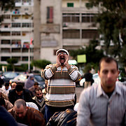 Several thousand Muslim Brotherhood supporters and islamist protesters who support president Morsi, gathered outside a local mosque in Cairo's Nasr City. A draft constitution has sparked outrage in post-revolution Egypt. A decision by Egyptian President Mohamed Morsi to extend his power during constitutional debate brought concerns about the growing influence of the Muslim Brotherhood, the movement from which he hails.
