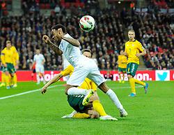 Tomas Mikuckis of Lithuania tackles Raheem Sterling of England (Liverpool)  - Photo mandatory by-line: Joe Meredith/JMP - Mobile: 07966 386802 - 27/03/2015 - SPORT - Football - London - Wembley Stadium - England v Lithuania - UEFA EURO 2016 Qualifier