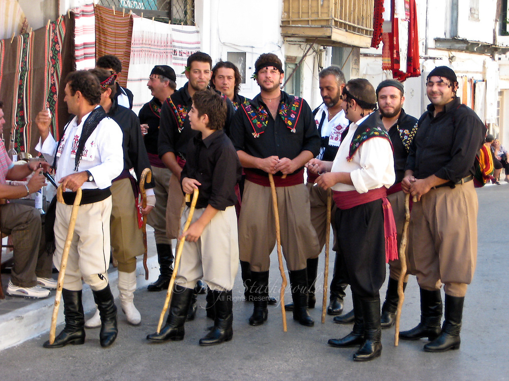 Youngsters, dressed in traditional Cretan costume, accompany the groom to Church.