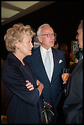 LORD & LADY CHADLINGTON at the preview of LAPADA Art and Antiques Fair. Berkeley Sq. London. 23 September 2014.