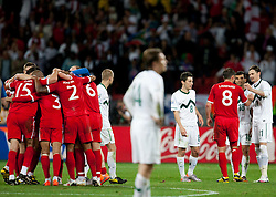Players of England celebrate, dissapointed Robert Koren of Slovenia, Aleksander Radosavljevic of Slovenia and Milivoje Novakovic of Slovenia after the 2010 FIFA World Cup South Africa Group C Third Round match between Slovenia and England on June 23, 2010 at Nelson Mandela Bay Stadium, Port Elizabeth, South Africa. England defeated Slovenia 1-0 and qualified for the next round, Slovenia not. (Photo by Vid Ponikvar / Sportida)