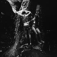 From a short distances from the beaches, Rio's rain forest offers waterfalls (&quot;cachoeiras&quot;) where the Cariocas refresh, in their peculiar way to be in harmony with nature. ///<br /> A quelques encablures des plages de Rio, la foret tropicale abrite de nombreuses &quot;cachoeiras&quot; , cascades de facile acces ou les  cariocas vont se rafraichir pendant l'&eacute;t&eacute;..