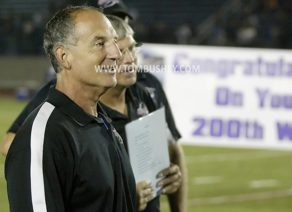 Monroe-Woodbury coach Pat D'Aliso talks to his team after the Crusaders defeated Middletown for his 200th career victory on Friday, Sept. 3, 2010.