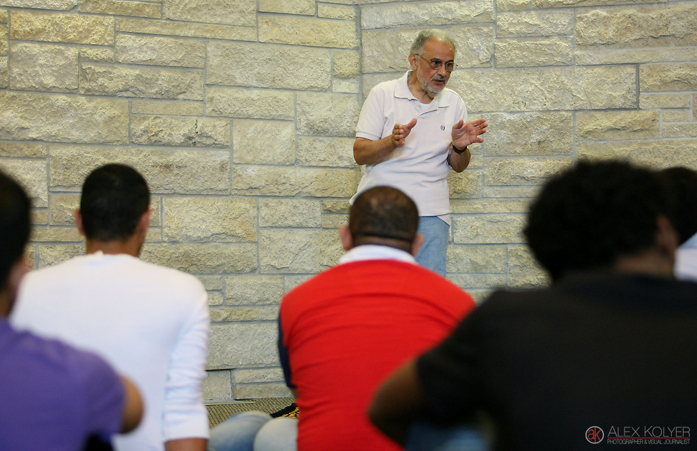 9/13/13--Winona<br /> Ahmed El-Afandi leads a prayer service at Central Lutheran Church Friday, Sept. 13, 2013, after the Islamic Center of Winona was destroyed by a fire earlier in the day. The Lutheran church offered a space for the Islamic Center members to hold their Friday prayer services. (Photo for MPR News by Alex Kolyer)