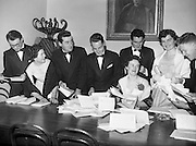 20/2/1959<br /> 02/20/1959<br /> 20 February 1959<br /> <br /> A group of young men and Ladies sorting paperwork at the Cunmann Gaelach Inaugural