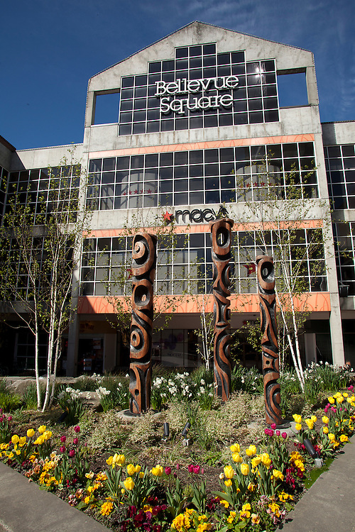 North America, United States, Washington, Bellevue, Bellevue Square shopping mall, with totem poles and garden at entrance