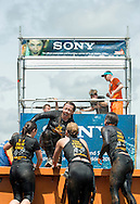 Mudders take on Sony's Arctic Enema 2.0 obstacle at Tough Mudder Scotland at Drumlanrig Castle, Thornhill, Scotland. on the 20th June, 2015