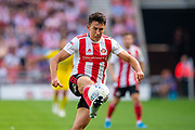 Luke O'Nien (#13) of Sunderland AFC during the EFL Sky Bet League 1 match between Sunderland and AFC Wimbledon at the Stadium Of Light, Sunderland, England on 24 August 2019.