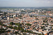 Nederland, Zuid-Holland, Dordrecht, 08-09-2006;  ; stadsgezicht met spoorbrug over de Oude Maas, op de tegenover gelegen oever van de rivier Zwijndrecht; binnenstad, stedelijkijheid verstedelijking, kerktoren, skyline; luchtfoto (toeslag); aerial photo (additional fee required); .foto Siebe Swart / photo Siebe Swart