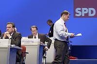 18 NOV 2003, BOCHUM/GERMANY:<br /> Olaf Scholz, SPD Generalsekretaer, auf dem Weg zum Rednerpult, und links: Gerhard Schroeder, SPD, Bundeskanzler, SPD Bundesparteitag, Ruhr-Congress-Zentrum<br /> IMAGE: 20031118-01-073<br /> KEYWORDS: Parteitag, party congress, SPD-Bundesparteitag, Gerhard Schröder