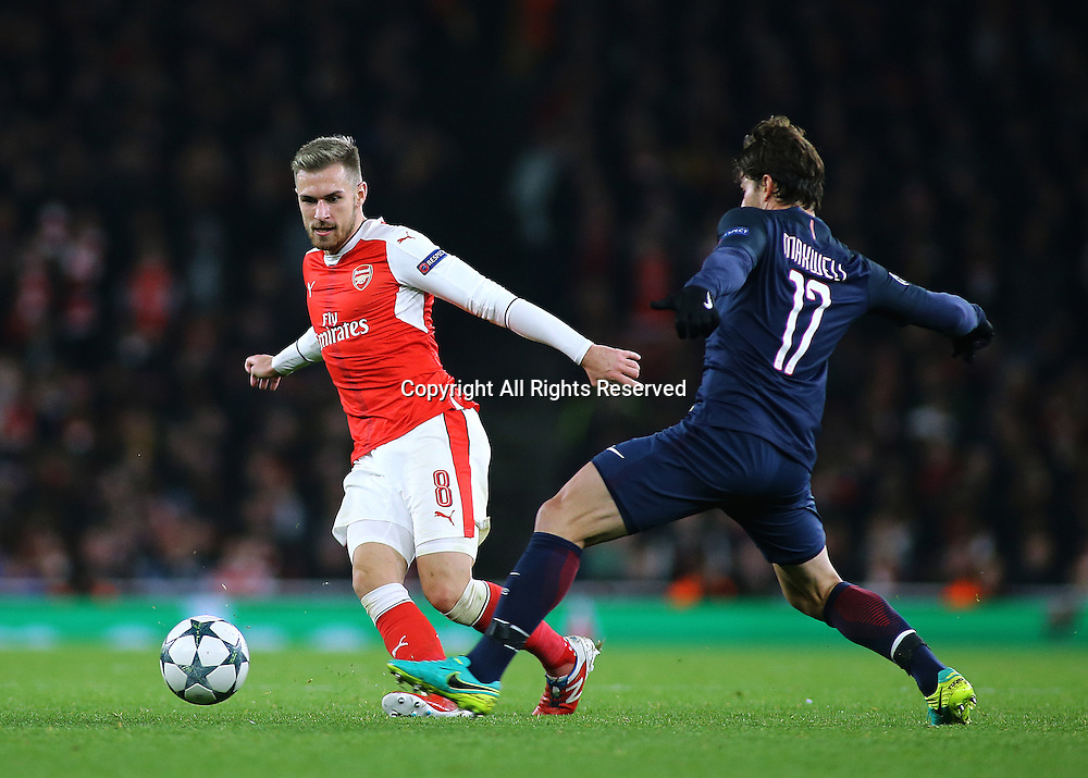 23.11.2016. Emirates Stadium, London, England. UEFA Champions League Football. Arsenal versus Paris Saint Germain. Arsenal Midfielder Aaron Ramsey knocks the ball forward, as Paris Saint-Germain Defender Maxwell closes him down