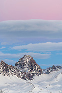 Pink and blue sky over mount Tinzenhorn at dusk, Savognin, Parc Ela, Grisons, Switzerland
