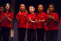 Ray Elementary School located at 5631 S. Kimbark Ave. held its annual black history month celebration Wednesday evening, February 21st, 2018. <br /> <br /> 4997, 5001 &ndash; The Chicago Children&rsquo;s Choir performed sang songs about civil rights.<br /> <br /> Please 'Like' &quot;Spencer Bibbs Photography&quot; on Facebook.<br /> <br /> Please leave a review for Spencer Bibbs Photography on Yelp.<br /> <br /> Please check me out on Twitter under Spencer Bibbs Photography.<br /> <br /> All rights to this photo are owned by Spencer Bibbs of Spencer Bibbs Photography and may only be used in any way shape or form, whole or in part with written permission by the owner of the photo, Spencer Bibbs.<br /> <br /> For all of your photography needs, please contact Spencer Bibbs at 773-895-4744. I can also be reached in the following ways:<br /> <br /> Website &ndash; www.spbdigitalconcepts.photoshelter.com<br /> <br /> Text - Text &ldquo;Spencer Bibbs&rdquo; to 72727<br /> <br /> Email &ndash; spencerbibbsphotography@yahoo.com