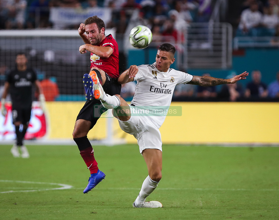 July 31, 2018 - Miami Gardens, Florida, USA - Manchester United F.C. midfielder Juan Mata (8) (left) and Real Madrid C.F. midfielder Javier Sanchez (32) (right) fight for the ball during an International Champions Cup match between Real Madrid C.F. and Manchester United F.C. at the Hard Rock Stadium in Miami Gardens, Florida. Manchester United F.C. won the game 2-1. (Credit Image: © Mario Houben via ZUMA Wire)