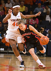 Georgia guard Ashley Houts (1) is challenged in the backcourt by Virginia guard Enonge Stovall (40).  The #15 ranked Virginia Cavaliers defeated the Georgia Lady Bulldogs 62-60 in NCAA Women's Basketball at the John Paul Jones Arena on the Grounds of the University of Virginia in Charlottesville, VA on January 2, 2009.