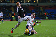 Bolton Wanderers defender David Wheater  tackles Brentford midfielder Ryan Woods  during the Sky Bet Championship match between Bolton Wanderers and Brentford at the Macron Stadium, Bolton, England on 30 November 2015. Photo by Simon Davies.