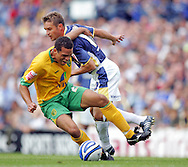 Cardiff - Saturday August 23rd, 2008: Stephen McPhail of Cardiff City brings down Darel Russell of Norwich City during the Coca Cola Championship match at The Ninian Park, Cardiff. (Pic by Paul Hollands/Focus Images)