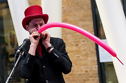 © Licensed to London News Pictures. 16/03/2016. London, UK. Magician, Magic Shaun, performs. Buskers and street performers entertain morning commuters in King's Cross station, as this year's Busk in London programme is launched.  Supported by the Mayor of London, the festival joins the International Busking Day and National Busking Day initiatives to celebrate street performances. Photo credit : Stephen Chung/LNP