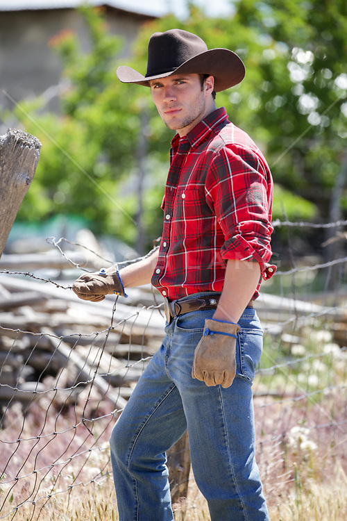 sexy cowboy working outdoors