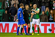 Referee Steven McLean steps between Andy Halliday (#16) of Rangers FC and David Gray (#2) of Hibernian FC during the Ladbrokes Scottish Premiership match between Hibernian and Rangers at Easter Road, Edinburgh, Scotland on 8 March 2019.