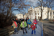 "Ringstrasse. The Burgtheater. Ice skaters passing by on the ""Wiener Eistraum"" ice skating ring."