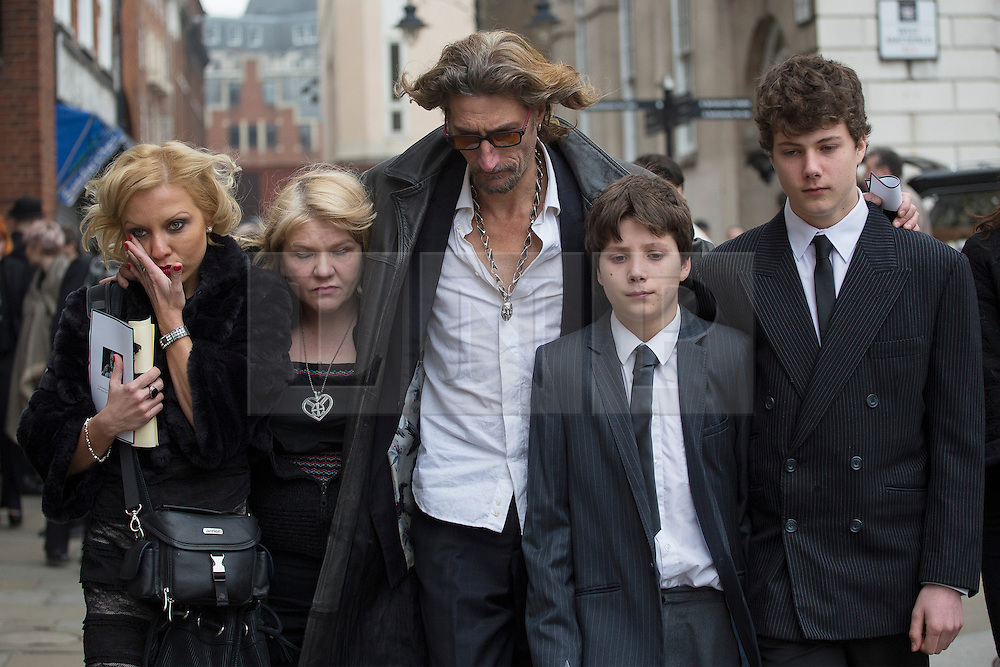 © licensed to London News Pictures. London, UK 20/03/2013. Nick Reynolds (centre) son of great train robber Bruce Reynolds and his family, leaving Bruce Reynolds' funeral at St Bartholomew The Great in London. Photo credit: Tolga Akmen/LNP